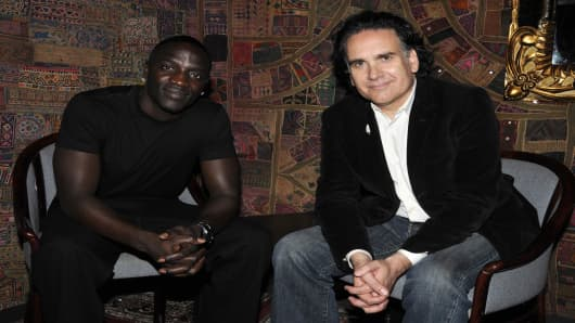 Musicians Akon and Peter Buffett pose for a photograph as they announce a socially conscious musical collaboration and website.