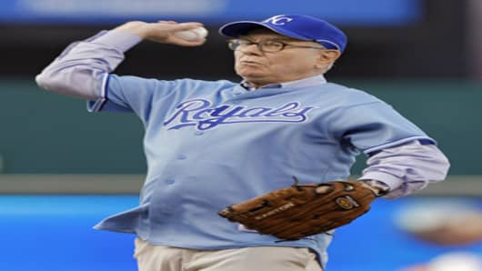 Warren Buffett throws out the ceremonial first pitch before tonight's game between the Kansas City Royals and the Texas Rangers