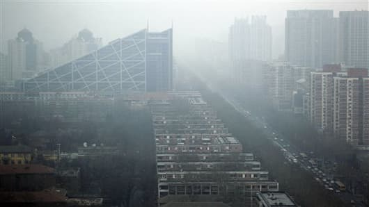 Taken through a glass window, buildings are obscured by haze in Beijing, China.
