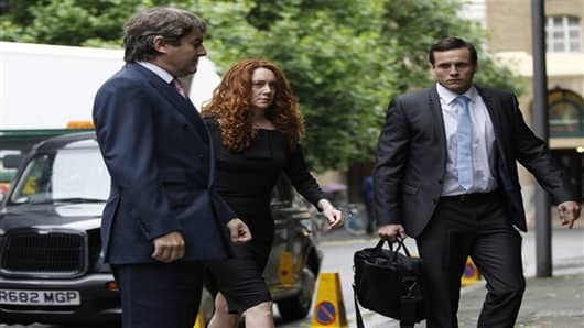 Former News International chief executive Rebekah Brooks, center.