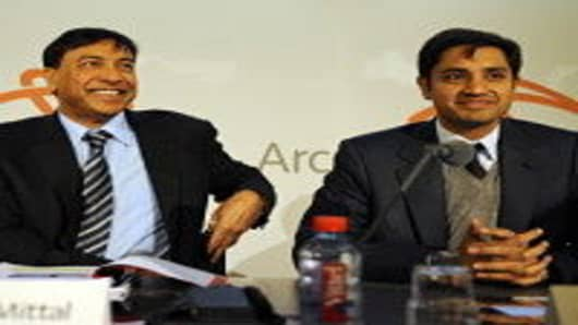 Lakshmi Mittal (L), the chairman and chief executive officer of the world's largest steel company, ArcelorMittal, with his son Aditya Mittal (R), who is the chief financial officer.