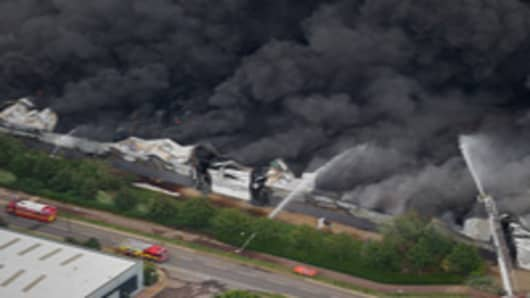 An aerial view of the Sony distribution center engulfed in fire on the 9th August, 2011 in London. Widespread looting, arson and clashes with police continued for a third day in parts of the capital, as well as in Liverpool, Birmingham and Bristol, as the disruption carries into a fourth night.