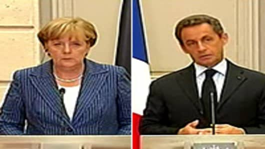 German Chancellor Angela Merkel and France's President Nicolas Sarkozy speak at a meeting on debt crisis.