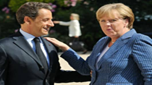 France's President Nicolas Sarkozy (L) welcomes German Chancellor Angela Merkel as she arrives for a meeting on debt crisis on August 16, 2011 at the Elysee presidential palace in Paris.