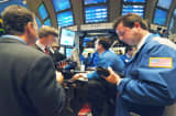 Traders on the floor of the New York Stock Exchange gather around a Bank of America trading post just prior to the announcement by the Federal Reserve that it had raised a key interest rate for the twelfth consecutive time, Tuesday, November 1, 2005. The Federal Reserve, still concerned about inflation, raised the interest rate to the highest level in more than four years and signaled more increases are likely.  (AP Photo/Henny Ray Abrams)