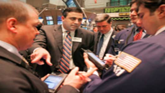 Traders at the NY Stock Exchange