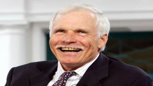 CNN founder Ted Turner reacts as he speaks about Gerald Levin, the former CEO of AOL Time Warner, while speaking at the CNN 25 World Report Conference in Atlanta in this Wednesday, June 1, 2005 file photo. Turner received the Clinton Center Award for Leadership and National Service Wednesday, June 29, 2005, for his work as an environmentalist in New York. The award is given by the Democratic Leadership Council, a Washington-based nonprofit organization comprised of Democratic legislators and gov