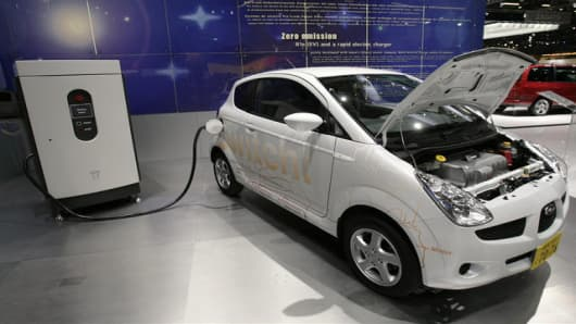 The new Subaru R1e Electric vehicle with rapid electricity charger is shown during the press day  at the 77th Geneva International Motor Show, Tuesday, March 6, 2007, in Geneva, Switzerland. The Motor Show will open its gates to the public from March 8 to 18. (AP Photo/Keystone, Martial Trezzini)