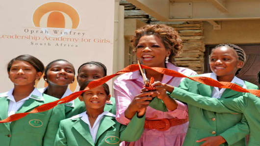 U.S. talk show queen Oprah Winfrey and learners cut the ribbon at the official opening of her Leadership Academy for Girls School at Henley-on-Klip, South Africa, Tuesday, Jan. 2, 2007. Winfrey opened the world class school for poor but talented South African girls fulfilling a long-cherished dream and a promise to her hero, Nelson Mandela.  (AP Photo/Denis Farell)