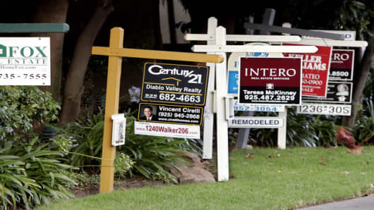Real estate signs posted at a housing complex in Walnut Creek, Calif., Saturday, Aug. 5, 2006. Home sales kept falling in July in Northern California along with the appreciation rate of prices, a real estate research firm reported Wednesday.  (AP Photo/Paul Sakuma)