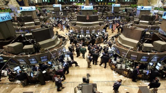 Traders and Specialists work the trading floor at the New York Stock Exchange on the first trading day in October Monday, Oct.  2,  2006. Stocks closed lower for the second straight session after the Dow Jones industrial average flirted briefly early in the day with its all-time high close. (AP Photo/David Karp)