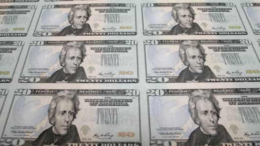 The new Series 2006 $20 currency notes, bearing the signatures of Treasury Secretary Henry Paulson and Anna Escobedo, treasurer of the United States, are seen at the Bureau of Engraving and Printing in Washington, Monday, Oct. 23, 2006. (AP Photo/J. Scott Applewhite)