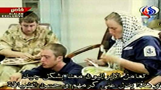Faye Turney, 26, right, the only woman amongst the British navy personnel seized by Iran,  an unidentified sailor, centre, and an unidentified marine, eat a meal,  in this image made from television,  in footage broadcast by Al-Alam, an Arabic-language, Iranian state-run television station, in Tehran, Wednesday March 28, 2007.(AP Photo/APTN, courtesy of Al-Alam)  ** IRAN OUT: TV OUT **