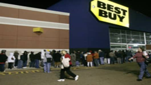 Shoppers rush to get in line outside of the Best Buy early Friday, Nov. 24, 2006, in Jackson, Miss., to take advantage of the Black Friday bargains. (AP Photo/Rogelio V. Solis)