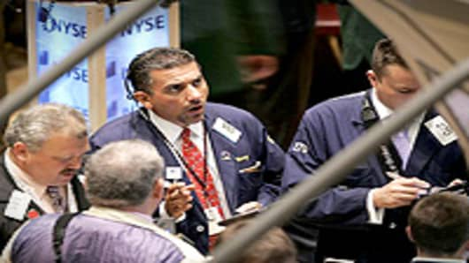 Broker works the trading floor at the New York Stock Exchange.