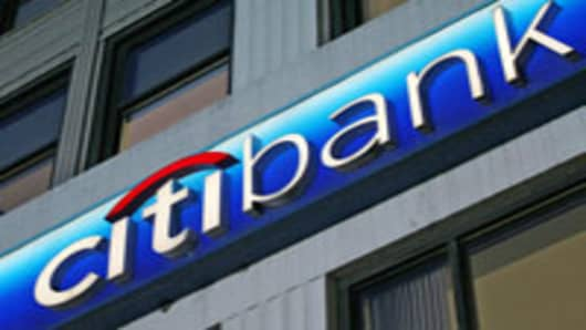 The Citibank logo is shown on a branch office Wednesday, April 11, 2007 in New York. Citigroup Inc., which includes Citibank, announced Wednesday that it will eliminate about 17,000 jobs as part of a companywide restructuring to reduce costs and improve profits. (AP Photo/Mark Lennihan)