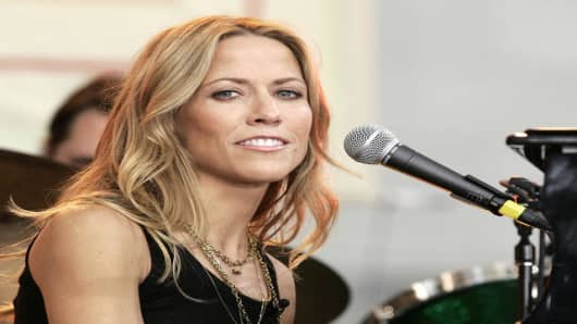 "Musician Sheryl Crow performs on ABC's ""Good Morning America"" summer concert series in New York's Bryant Park, Friday, Sept. 23, 2005. Crow's new album ""Wildflower"" goes on sale Sept. 27. (AP Photo/Jeff Christensen)"