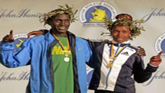 2006 Boston Marathon men's winner Robert Cheruiyot of Kenya, and women's winner Rita Jeptoo of Kenya.