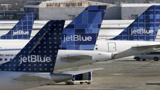 JetBlue planes wait at terminal gates at JFK Airport in New York, Friday, Feb. 16, 2007. JetBlue travelers continued to experience delays and cancellations Friday as the airline struggled for a third day to recover from an operational meltdown at John F. Kennedy International Airport. (AP Photos/Bebeto Matthews)