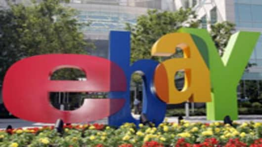 An Ebay sign is shown at Ebay offices in San Jose, Calif., Wednesday, July 20, 2005. The San Jose-based company said Wednesday that it earned $291.6 million, or 21 cents per share, for the three months ended in June, a 53 percent increase from $190.4 million, or 14 cents per share at the same time last year. (AP Photo/Paul Sakuma)