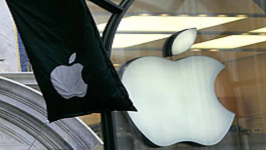 A flag showing the Apple Computer logo flies outside the Apple shop in Regent Street, London