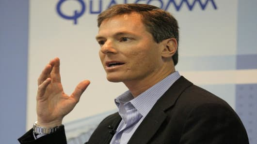 Paul Jacobs, CEO of QUALCOMM, gestures as he speaks on QUALCOMM'S mobile multimedia technology during a news conference at the Cellular Communications and Internet Association convention in Las Vegas, Wednesday, April 5, 2006. (AP Photo/Jae C. Hong)