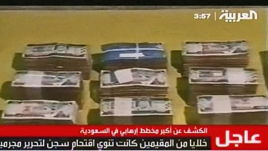 A video still from Al Arabiya TV, showing money discovered by Saudi security officials during raid on militants.
