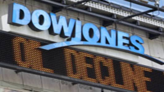 "News headlines from Dow Jones scroll on the ""zipper"" around the 1 Times Square Building, in New York."
