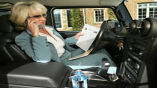 Female Realtor works from the driver's seat of a Hummer H2.