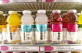 Bottles of Vitaminwater are displayed in a convenience. The Coca-Cola Co., which has been looking to expand its water and energy drink portfolio, said Friday it has agreed to buy Vitaminwater maker Glaceau in a cash deal valued at $4.1 billion.