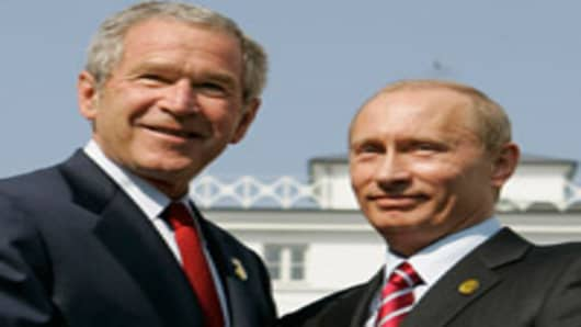 President Bush, left, shakes hands with Russian President Vladimir Putin after their meeting at the G8 Summit in Heiligendamm, Germany, Thursday June 7, 2007.