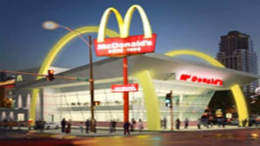 "Today, McDonald's Corporation marked the beginning of its 50th anniversary celebration by introducing its 50th anniversary restaurant design at an event at the ""Rock 'n' Roll McDonald's"" in downtown Chicago. This rendering of McDonald's one-of-a-kind futuristic restaurant design which will be built on its Chicago flagship site at 600 N. Clark Street is expected to open in April 2005. McDonald's founder Ray Kroc opened his first restaurant in Des Plaines, Illinois, on April 15, 1955. (PRNewsfoot)"