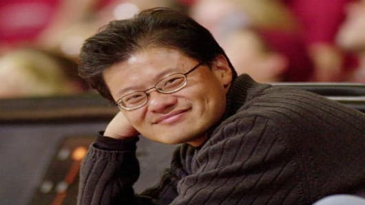 Yahoo! co-founder Jerry Yang smiles as he watches the Stanford basketball game against Washington State, Thursday, March 3, 2005 in Stanford, Calif. Yahoo! celebrated their 10th anniversary this week. David Filo and Yang founded Yahoo! as doctoral students at Stanford. (AP Photo/Paul Sakuma)