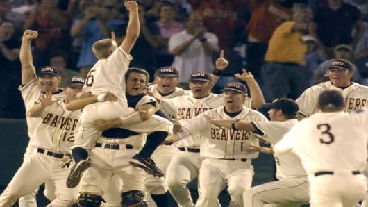 Oregon State players lift closing pitcher Kevin Gunderson (6) as they celebrate their 3-2 win over North Carolina in the deciding game of the baseball College World Series in Omaha, Neb., Monday, June 26, 2006. Oregon State beat North Carolina 3-2.(AP Photo/Dave Weaver)