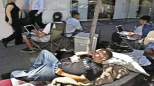 "A group who are calling themselves ""iWait"", wait to purchase an Apple iPhone outside of an Apple store in Walnut Creek, Calif., Wednesday, June 27, 2007. The iPhone is planned to go on sale Friday. (AP Photo/Paul Sakuma)"