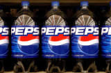 Pepsi bottles line the self of a supermarket in Springfield, Ill., Tuesday, July 11, 2006.  PepsiCo Inc., the No. 2 soft-drink maker, said second-quarter profit jumped 14 percent, helped by sales of non-carbonated beverages.  (AP Photo/Seth Perlman)