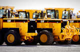 **FILE** Rows of heavy Caterpillar equipment sits ready for shipment at the Caterpillar plant in Decatur, Ill.,in this April 20, 2007 file photo. For American companies with operations that stretch overseas, the slumping dollar has become a fiscal life preserver amid slower domestic economic growth and waning sales. (AP Photo/Seth Perlman, file)