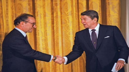 President Reagan congratulating Alan Greenspan in August 1987 after he was sworn-in as new chairman of the Federal Reserve Board.