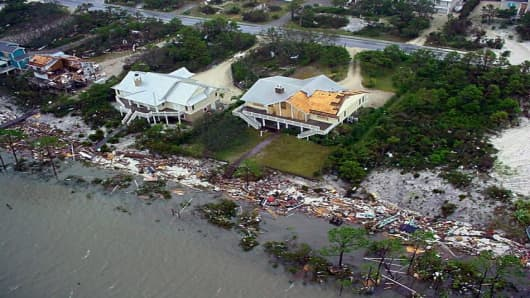 Debris litters the beach Thursday, Sept. 16, 2004, in Pensacola, Fla., in an aerial photo taken by the U.S. Coast Guard.  The Coast Guard, along with the Federal Emergency Management Agency, spent most of the day assessing damage to ports, waterways, land and property.  (AP Photo/U.S. Coast Guard Air Station New Orleans)