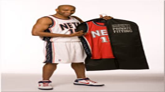 Nets guard Vince Carter with the garment bag.