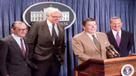 U.S. President Ronald Reagan announces the appointment of Alan Greenspan, left, as his choice to replace Paul Volcker, center, as chairman of the Federal Reserve Board at a White House briefing, Tuesday morning on June 2, 1987. The man at right is Secretary of Treasury James A. Baker III.