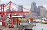 A container ship from Korea sits at a loading dock at Seattle's Harbor Island near downtown, Thursday, May 11, 2006. The U.S. trade deficit unexpectedly declined in March for a second consecutive month, something that hasn't happened in more than two years. The improvement reflected record U.S. exports and a big drop in the country's foreign oil bill. (AP Photo/Elaine Thompson)