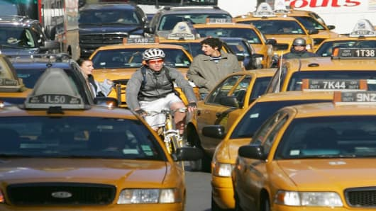 A cyclist navigates the street jammed by traffic in New York's Times Square Saturday, Nov. 19, 2005. With a month left in the year, police records show 21 cyclists have died in traffic accidents in New York, up from 15 in all of 2004. (AP Photo/ Dima Gavrysh)