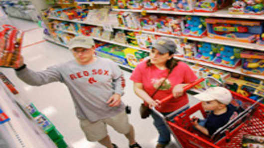 Shoppers in a toy aisle at a Target store.