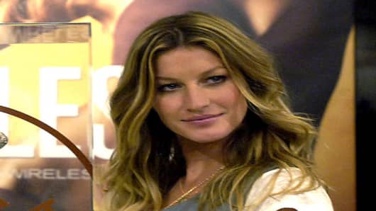 "Supermodel Gisele Bundchen appears at a photo call to launch the new ""Body By Victoria IPEX Wireless"" bra at a Victoria's Secret store Wednesday, March 1, 2006 in New York.  (AP Photo/Jason DeCrow)"