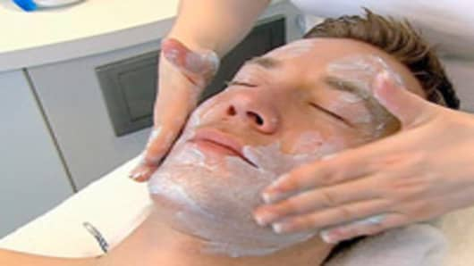 Aesthetician performing a facial