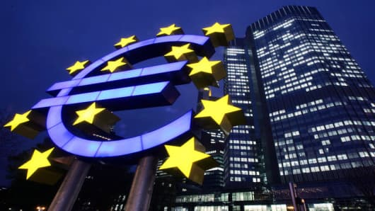 The Euro sculpture is seen in front of the European Central Bank in Frankfurt, central Germany, Wednesday, Nov. 30, 2005, the day before a possible change of the main interest rate by the European Central Bank. (AP Photo/Michael Probst)