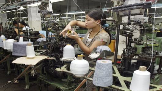 A Chinese woman works at a textile factory in China.