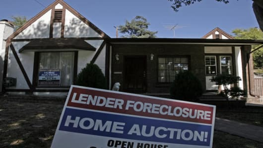 A sign showing a foreclosed house is seen in Glendale, Calif., Monday, August 20, 2007.  Foreclosure filings rose 9 percent from June to July and surged 93 percent over t
