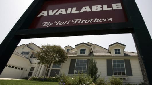 A home is offered for sale at the Toll Brothers Country Club Estates luxury housing development in Moorpark, Calif., Wednesday, Aug. 22, 2007. The upscale homebuilder Toll Brothers Inc. said Wednesday its third-quarter profit tumbled, hurt by hefty writedowns and higher-than-expected cancellations as the housing downturn and credit quality concerns continue. Robert Toll, chairman and chief executive, said cancellation rates for the quarter were greater than at any point in the 21 years the compa